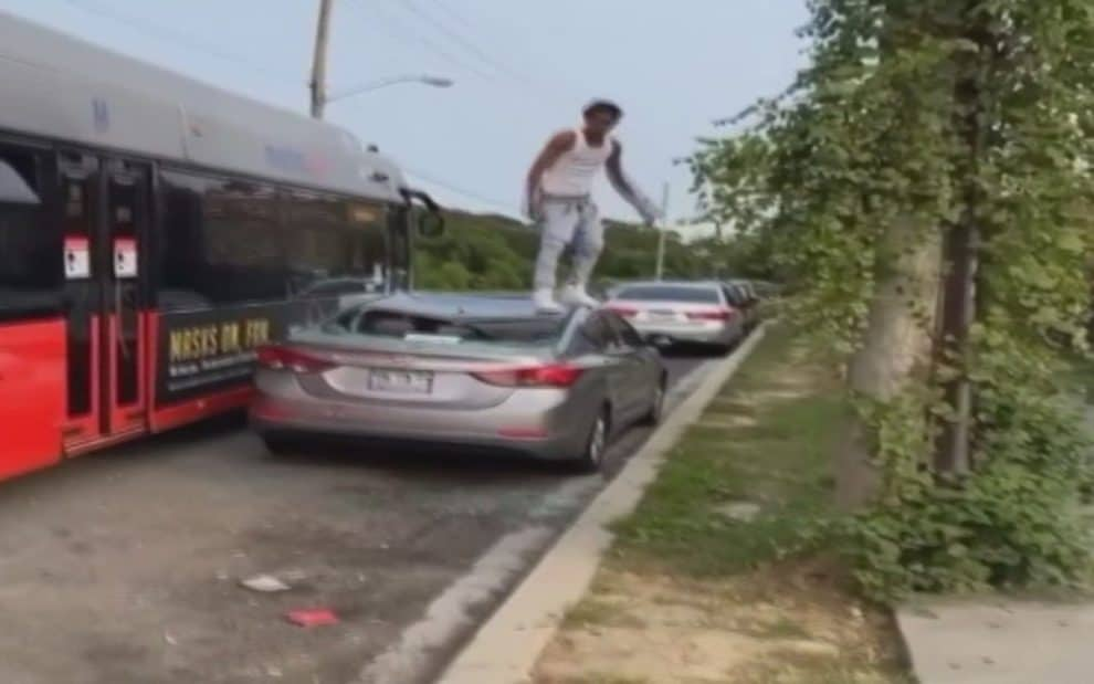 Man jumps from Metro bus to car Viral Video