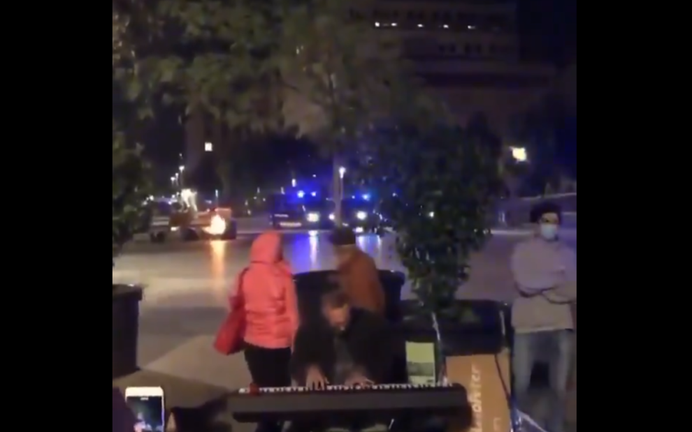 video man playing piano protests Barcelona Spain